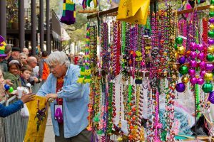 Mardi Gras vendor in Mobile, Alabama with beads and throws